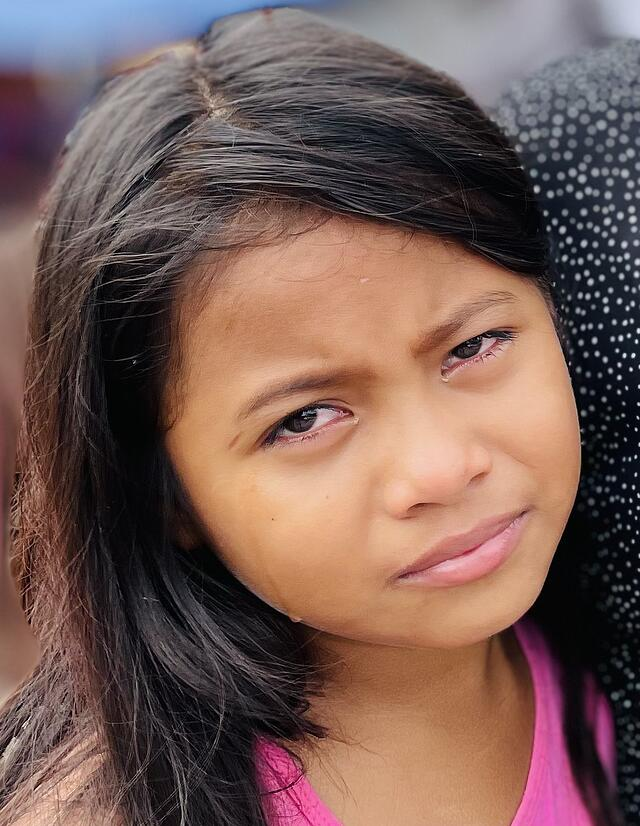 hispanic girl with tears border