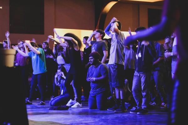worship-ywam-missionary-people-kneeling-inspire